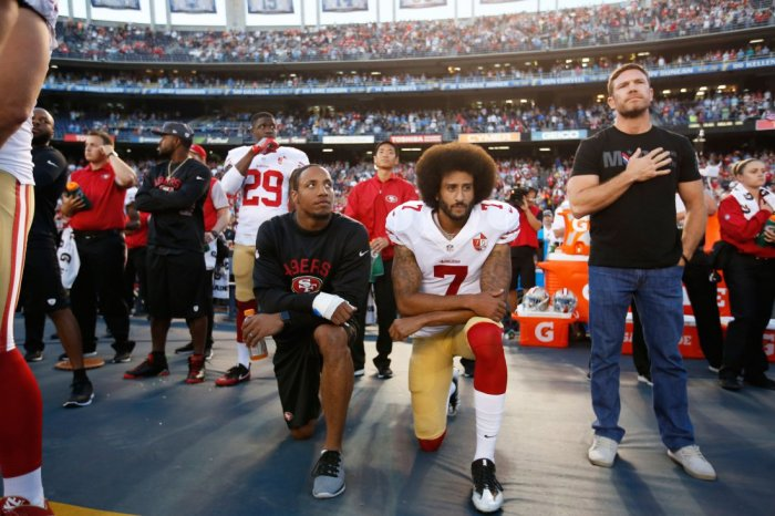 SAN DIEGO, CA - SEPTEMBER 1: Eric Reid #35 and Colin Kaepernick #7 of the San Francisco 49ers kneel on the sideline during the anthem, as free agent Nate Boyer stands, prior to the game against the San Diego Chargers at Qualcomm Stadium on September 1, 2016 in San Diego, California. The 49ers defeated the Chargers 31-21. (Photo by Michael Zagaris/San Francisco 49ers/Getty Images)