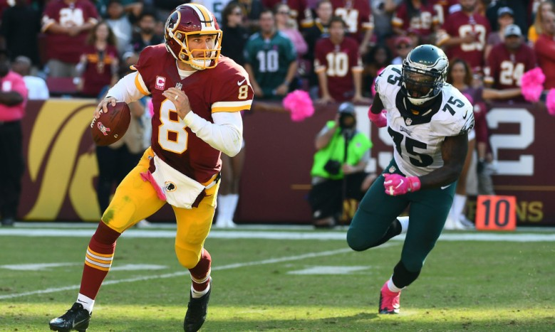 Oct 16, 2016; Landover, MD, USA; Washington Redskins quarterback Kirk Cousins (8) rolls out as Philadelphia Eagles defensive end Vinny Curry (75) defends during the second half at FedEx Field. Mandatory Credit: Brad Mills-USA TODAY Sports