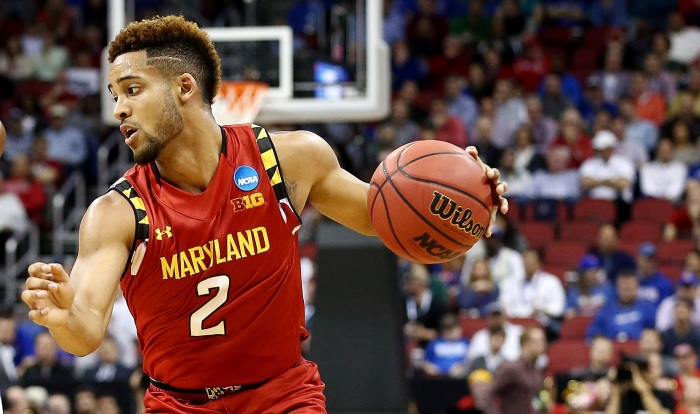 Mar 24, 2016; Louisville, KY, USA; Maryland Terrapins guard Melo Trimble (2) handles the ball against Kansas Jayhawks guard Devonte' Graham (4) during the first half in a semifinal game in the South regional of the NCAA Tournament at KFC YUM!. Mandatory Credit: Aaron Doster-USA TODAY Sports
